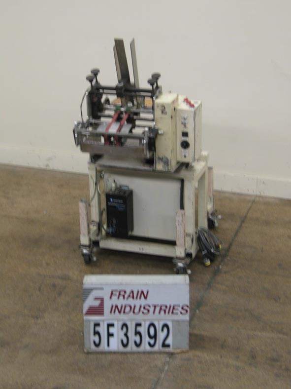 Photo of Feeder Coupon Inserter