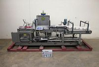 Photo of Hartness Case Packer Drop Packer L-130 